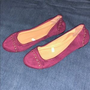 Purple suede flats with gold embellishment